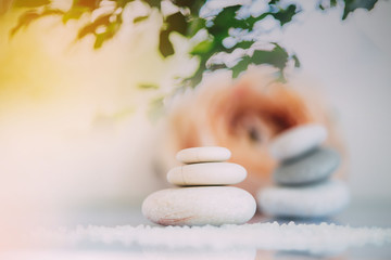 Spa still life with stacked of stone. Holiday, body care and luxury concept.