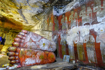 Buddha statue inside Dambulla cave temple on February 8, 2020 in Dambulla, Sri Lanka. Cave I Devaraja Viharaya. Major attractions are spread over 5 caves, which contain statues and paintings.