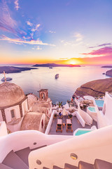 Self adhesive Wall Murals Santorini Amazing evening view of Santorini island. Picturesque spring sunset on the famous Greek resort Fira, Greece, Europe. Traveling concept background. Artistic style post processed photo. Summer vacation