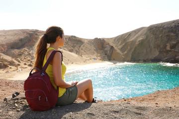 Deurstickers Canarische Eilanden Beautiful young backpacker admiring Playa Papagayo beach in Lanzarote, Canary Islands, Spain