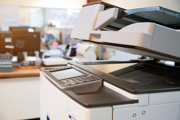 Close-up photocopier or printer is office worker tool equipment for scanning and copy paper. Wall mural