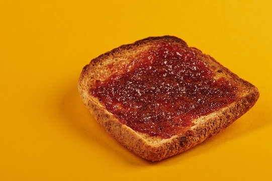 Side view of toast with jam