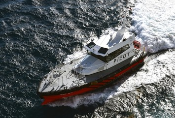 Pilot boat creating white water whilst traavelling at speed