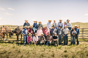 Group foto of cowboys and cowgirls who took part in a branding. Cody, Wyoming, USA