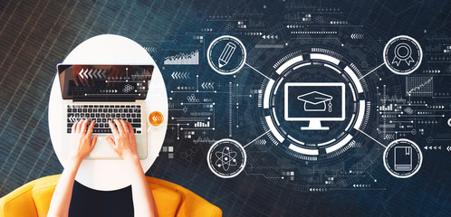 Wall Mural - E-learning concept with person using a laptop on a white table