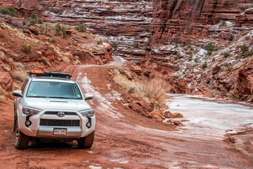 Toyota 4runner SUV on a canyon trail in winter conditions