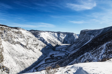 View of the mountain valley with the Chulyshman river in winter, Katu-Yaryk pass. Altai republic