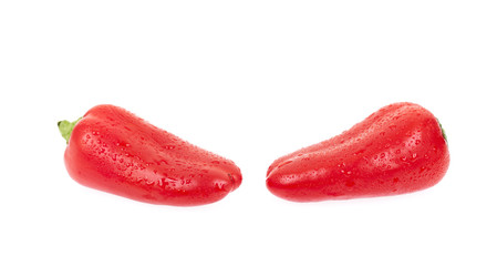 Two red peppers with water droplets isolated on white backgroud.