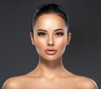 Front portrait of the woman with beauty face - isolated. Beauty face of the young beautiful girl with a healthy skin.  Skin care concept.