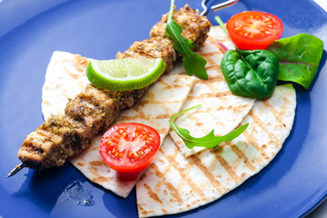 Greek skewers of chicken with oregano