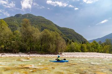 Kayakers on Soca river, Slovenia