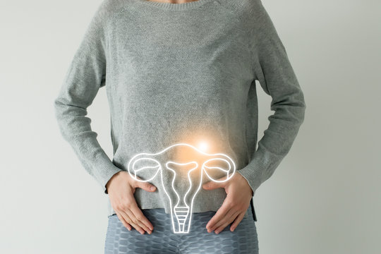 Woman in casual grey clothes suffering from indigestion pain, highlighted vector visualisation of uterus