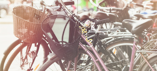 Retro bikes parked on the street in Stockholm, Sweden. Toned picture, soft focus