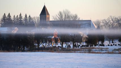 A layer of frozen fog hangs above a field near a Tyendinaga Mohawk Territory camp at a railway crossing