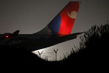 A Nepal Airlines Airbus A330-200 plane carrying 175 Nepalese nationals from the coronavirus-stricken Chinese city of Wuhan lands at Tribhuvan International Airport in Kathmandu