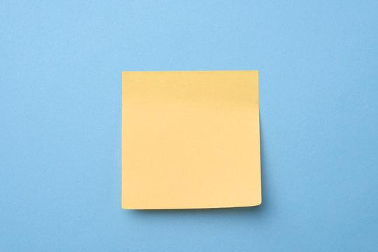 Yellow sticky note on light blue background