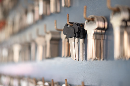 Close up of key hanging on wall in key maker shop
