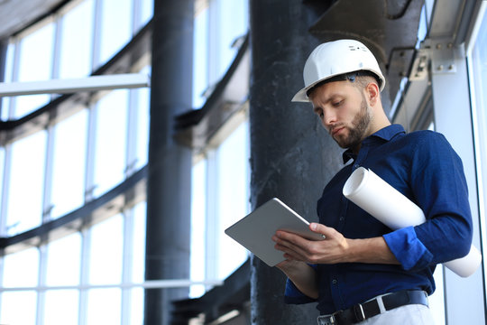 Shot of a engineer using a digital tablet on a construction site. This software help me to keep track of everything.