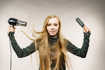 Girl styling her long hair
