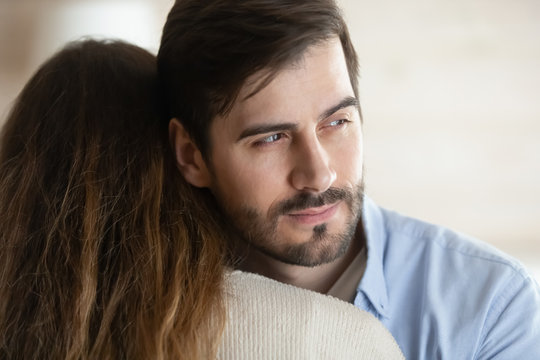 Pensive young man hug wife think of relationship problems