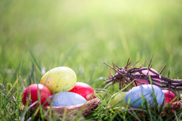 easter eggs in grass background with crown of thorns
