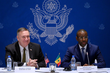 Senegal's Minister of Economy, Planning and International Cooperation Amadou Hott speaks next to U.S. Secretary of State Mike Pompeo during a meeting with business leaders in Dakar
