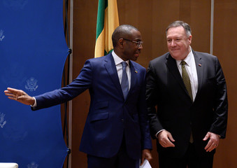 Senegal's Minister of Economy, Planning and International Cooperation Amadou Hott speaks with U.S. Secretary of State Mike Pompeo during a meeting with business leaders in Dakar