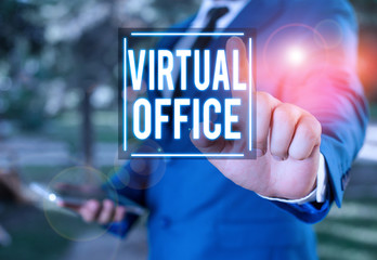 Handwriting text writing Virtual Office. Conceptual photo Mobile workenvironment equipped with telecommunication links Businessman with pointing finger in front of him