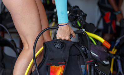 driver prepares the equipment for the dive. Equips the oxygen tank, close-up, depth of field.