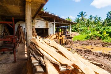 old simple sawmill in Asia, Sri Lanka, rusty equipment, bright Sunny day in tropics