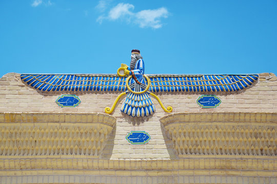 Zoroastrian symbol Faravahar from the facade of a fire temple in Yazd, Iran
