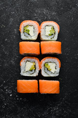 Traditional sushi - Philadelphia with salmon, avocado and cheese. Japanese cuisine. Top view.