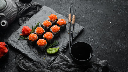 Sushi rolls with salmon and caviar. Traditional Japanese cuisine. Top view.