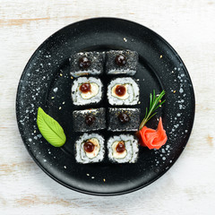 Set of sushi with eel fish and black sesame. Sushi menus. Top view. Free space for your text.