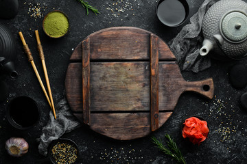 Asian cooking background. Spices and herbs on old table.