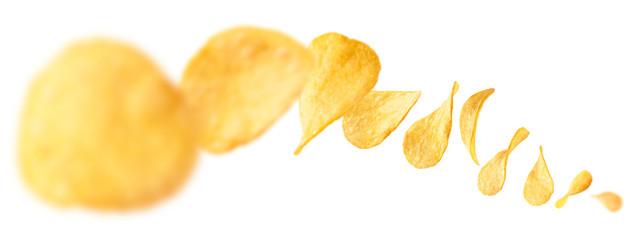 Potato chips levitate on a white background