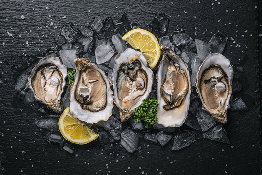 Fresh oysters with lemon ice and white wine.