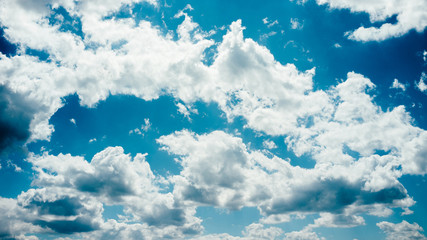 Blue sky background. Freedom hope dreams. White clouds. Sunny day. Fotomurales