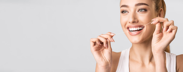Smiling Woman Flossing Perfect Teeth Standing Over Gray Background, Panorama