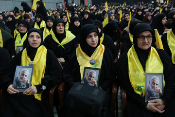 Supporters of Lebanon's Hezbollah leader Sayyed Hassan Nasrallah carry pictures of the late Iran's Quds Force top commander Qassem Soleimani during a rally commemorating in Beirut's southern suburbs