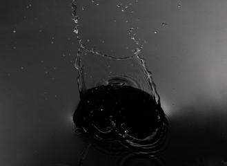 Fototapete - splash water on isolated black background