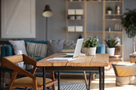 Cozy domestic workplace with wooden modern table
