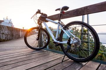 Aluminium Prints Bicycle Bicycle parking on the bridge at sunset.