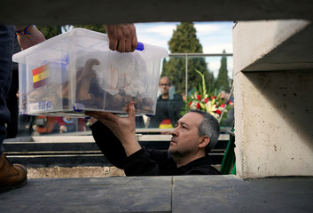 Members of the Association for the Recovery of Historical Memory of Valladolid (ARMH-Valladolid), take part in the burial of 245 people killed by the late Spanish dictator Francisco Franco's forces in Valladolid