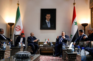Iranian parliament speaker Ali Larijani meets with Syrian parliament speaker Hammouda Sabbagh in Damascus