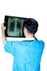 Young Asian doctor holding an X-Ray film on white background.