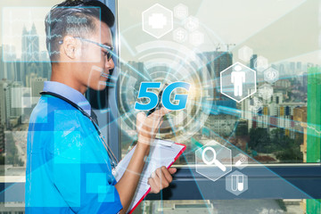 5G concept fast internet connection health care medical icon concept. Internet of things technology. Young Asian doctor monitoring and observe patient using technology via smartphone.