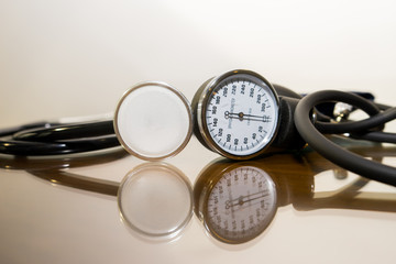 Close up stethoscope with sphygmomanometer meter for blood pressure measurement.