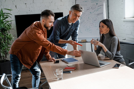 Adult smart people, education, training and staff development courses in big international company. Successful business strategy plan concept. Confident office worker indoor in coworking space.