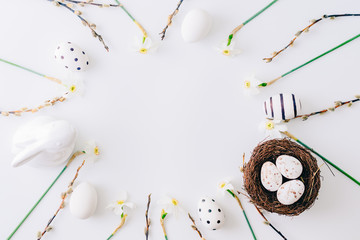 Flat lay easter composition with a white daffodils and eggs on a white background